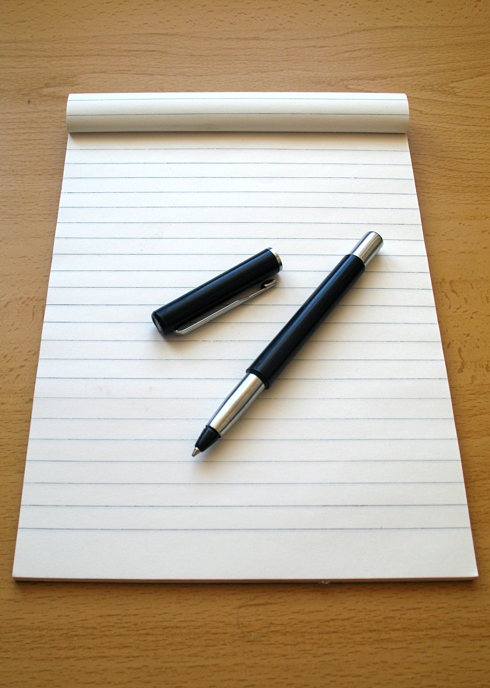 pen and blank lined paper