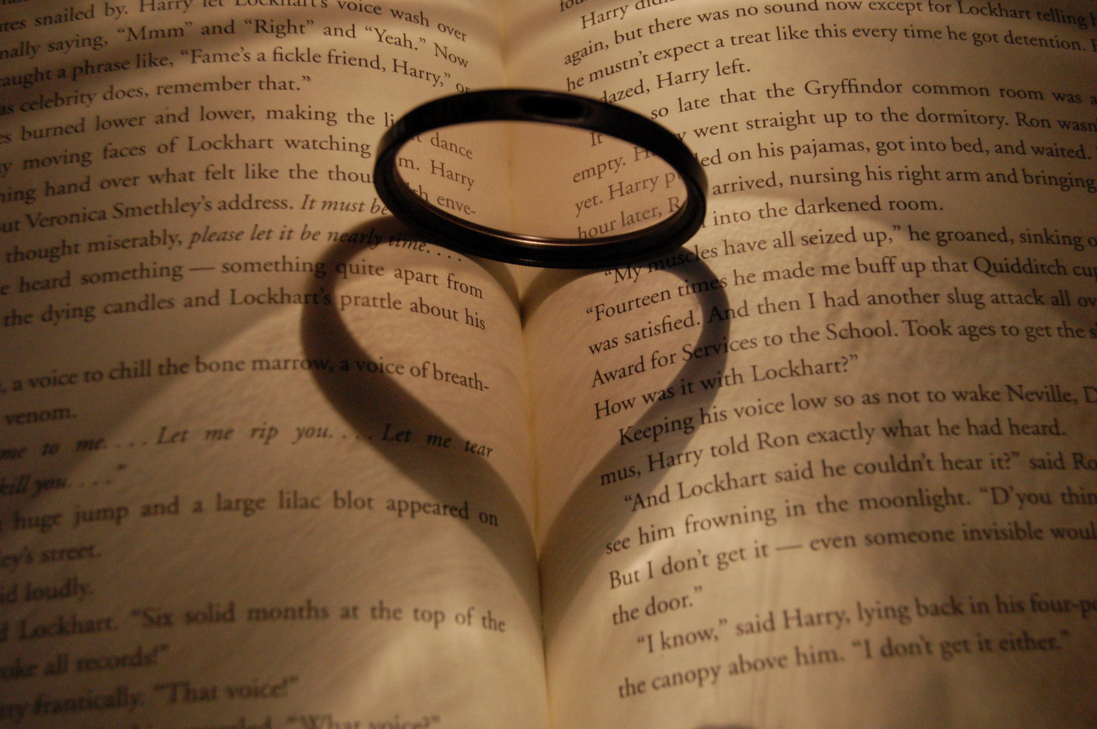 ring makes heart shadow on open book