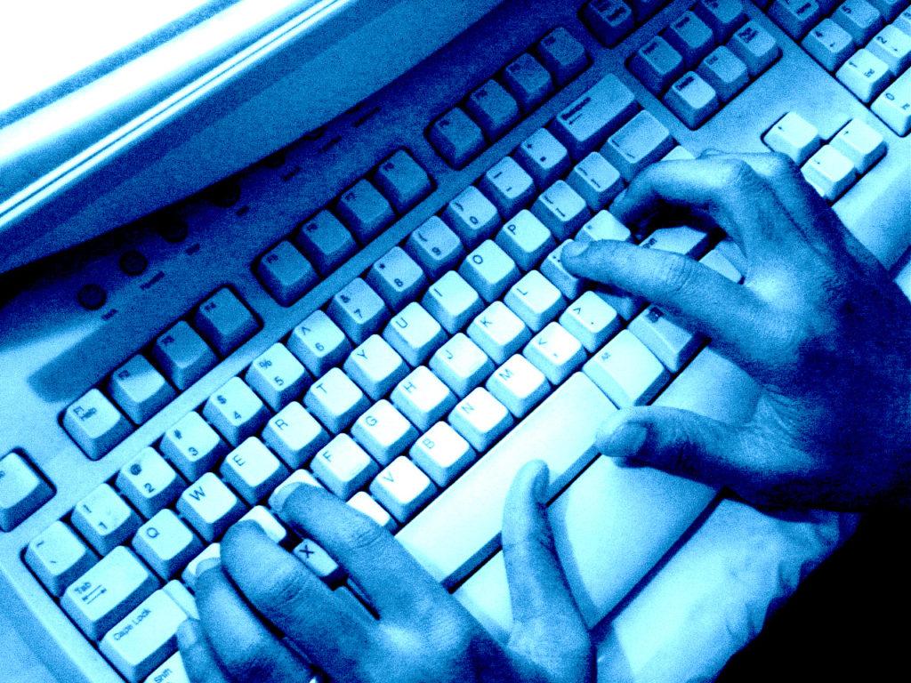 writing on computer keyboard